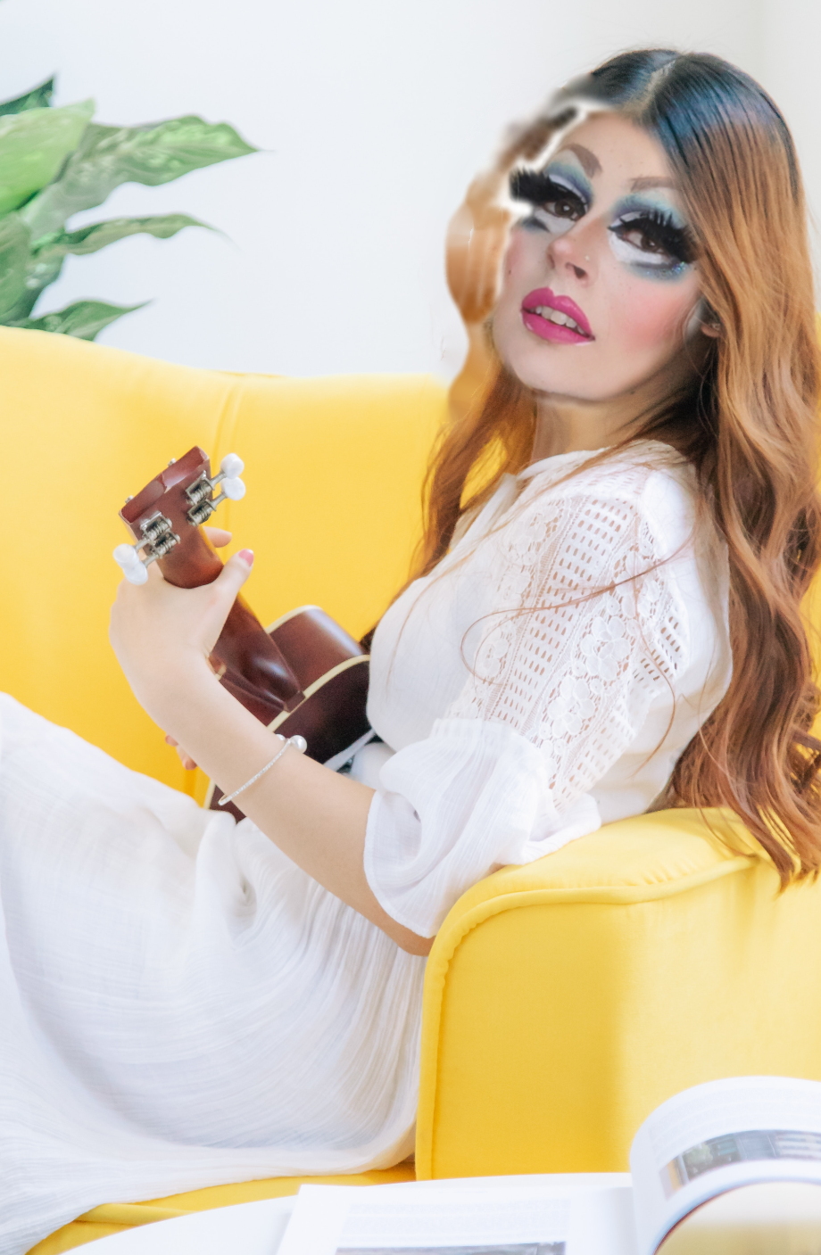 Photoshopped image showing Amber's face on the body of a girl playing ukulele and reading from a book